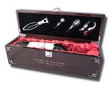 Our Sommelier Wine Box is the gift of elegance. Handsome piano finish mahogany wood encases a soft red, pillowy satin bed for your wine of choice. A complete tool set in the lid includes opener, nozzle, stopper and foil knife.